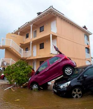 A photo taken on September 6, 2017 shows cars piled on top of one another in Marigot, near the Bay of Nettle, on the French Collectivity of Saint Martin, after the passage of Hurricane Irma.France, the Netherlands and Britain on September 7 sent water, emergency rations and rescue teams to their stricken territories in the Caribbean hit by Hurricane Irma, which has killed at least 10 people. The worst-affected island so far is Saint Martin, which is divided between the Netherlands and France, where eight of the 10 confirmed deaths took place. / AFP PHOTO / Lionel CHAMOISEAU