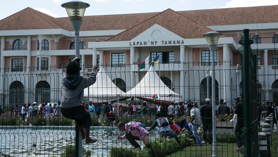 Protestors overtake the town hall during a opposition demonstration against a draft electoral law adopted by Madagascar